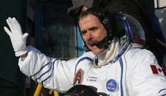 Canadian astronaut Chris Hadfield, a crew member of the mission to the International Space Station, gestures prior the launch of the Soyuz-FG rocket at the Russian leased Baikonur cosmodrome, Kazakhstan, Wednesday, Dec. 19, 2012. (AP Photo/Dmitry Lovetsky, Pool)