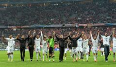 Real Madrid players celebrate after winning the Champions League semifinal second leg soccer match between Bayern Munich and Real Madrid at the Allianz Arena in Munich, southern Germany, Tuesday, April 29, 2014. (AP Photo/Kerstin Joensson)