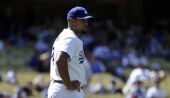Los Angeles Dodgers relief pitcher Kenley Jansen stands on the mound after giving up a two-run home run to Washington Nationals' Adam LaRoche during the ninth inning of a baseball game Wednesday, Sept. 3, 2014, in Los Angeles. (AP Photo/Jae C. Hong)