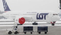 FILE - In this Feb. 22, 2013 file picture a Boeing 767 of the Polish airlines LOT stands on the tarmac of the Frederic Chopin airport in Warsaw, Poland. The European Union's antitrust authority on Tuesday July 29, 2014 approved the Polish government's 200 million-euro ($270 million) bailout for its ailing national carrier, LOT airlines. The 28-nation bloc's executive Commission said the assistance does not violate EU rules limiting state aid to businesses since it will