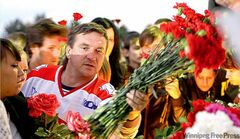 Lokomotiv fans lay flowers and light candles at the Lokomotiv Arena.
