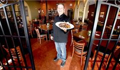Steve Kandalakis shows off a plate of lamb chops.
