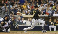Pittsburgh Pirates' Jordy Mercer watches his line drive single to center that drives in Starling Marte during the fourth inning of a baseball game Monday, June 2, 2014, in San Diego. (AP Photo/Lenny Ignelzi)