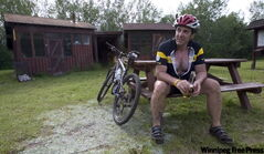 Free Press photo editor Jon Thordarson takes a break after completing a long-distance bicycle run in 2007.
