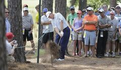 Ernie Els, of South Africa, hits out of the pine needles on the third hole during a practice round for the U.S. Open golf tournament in Pinehurst, N.C., Wednesday, June 11, 2014. The tournament starts Thursday. (AP Photo/Eric Gay)