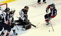 Goalie Mark Segal (31) and Neil Manning (8) of the Vancouver Giants defend the goal from Brendan Shinnimin (24) and Adam Hughesman (17) of the Tri-City Americans in WHL playoff action in 2010
