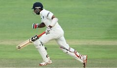 India's batsman Cheteshwar Pujara makes a run during their 2nd innings on the third day of their cricket test match against South Africa at Wanderers stadium in Johannesburg, South Africa, Friday, Dec. 20, 2013. (AP Photo/ Themba Hadebe)