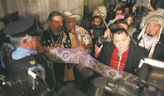 First Nations leaders talk to the media outside the House of Commons Tuesday.