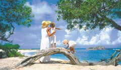 Mom and kids at the beach, St. Regis Punta Mita Resort. Beach lovers will find the Riviera Nayarit has many kilometres of pristine shorelines.