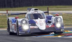 The Toyota TS 040 driven by Alexander Wurz of Austria, Stephane Sarrazin of France and Kazuki Nakajima of Japan in a curve of the Mans circuit, during a free practice session for the 24-hour Le Mans endurance race, in Le Mans, western France, Wednesday, June 11, 2014. The race will take place on Saturday and Sunday. (AP Photo/Remy de la Mauviniere)