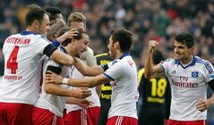Hamburg's Petr Jiracek of Czech Republic celebrates with treammates after scoring during the German first division Bundesliga soccer match between Hamburg SV and BvB Borussia Dortmund in Hamburg , Germany, Saturday, Feb. 22, 2014. (AP Photo/Frank Augstein)