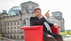 "German vice chancellor and Minister for Economy, Sigmar Gabriel attends an interview by German TV channel ARD in Berlin, Sunday July 27, 2014. In background the parliament building 'Reichstag' . Germany's vice chancellor says Europe should take aim at rich businesspeople who support Russia's government as it increases pressure on Moscow over its actions in Ukraine. Sigmar Gabriel, who is also Germany's economy minister, told ARD television Sunday that measures should target ""those on whose shoulders the Russian government stands: the oligarchs, the billionaires."" (AP Photo/dpa/Hannibal Hanschke)"