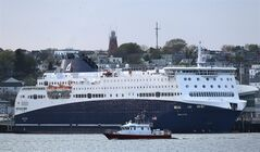 The 528-foot, $165 million Nova Star ferry dwarfs the city of Portland's fire boat as it prepares to leave Portland, Maine,Thursday night on its first commercial run to Yarmouth, Nova Scotia, Canada, Thursday, May 15, 2014. The ship has 162 cabins that range from $99 to $249 a night in the summer. (Photo/Robert F. Bukaty)