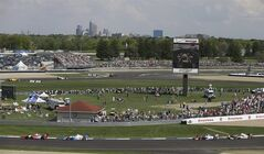 Drivers make their way around the track during the inaugural Grand Prix of Indianapolis IndyCar auto race at Indianapolis Motor Speedway in Indianapolis, Saturday, May 10, 2014. (AP Photo/Darron Cummings)