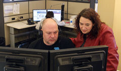 Here's how a desperate call to 311 can lead to thawed pipes and patched potholes. From left, operator Kyle Smoley and 311 Contact Centre manager Melanie Swenarchuk collaborate on a call.