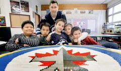 Teacher Robert Hewitt with Strathcona School students (from left) Marlin Sison, Dayton Simard, Malik Harb, Dakota Sass and Joe Clark, with Lego logo.