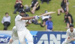 India's Virat Kohli bats against New Zealand on the final day of the second test at the Basin Reserve in Wellington, New Zealand, Tuesday, Feb. 18, 2014. (AP Photo/SNPA, Ross Setford) NEW ZEALAND OUT