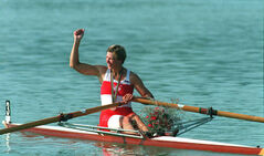 Silken Laumann raises her arm in gesture as she leaves the winners area with her gold medal for the Olympic women's single scull competition in 1992.