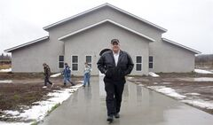 Winston Blackmore is seen outside his community hall in the isolated religious commune of Bountiful, B.C., on Nov. 23, 2011. Legal experts say a criminal case involving a polygamous sect in B-C will probably reignite a debate over whether the ban on multiple marriages violates the right to religious freedom. Both Winston Blackmore and James Oler face charges of having multiple marriages in a religious commune in southeastern B.C. known as Bountiful. THE CANADIAN PRESS/Jonathan Hayward