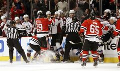 A scuffle breaks out between the Chicago Blackhawks and the Colorado Avalanche in front of the Avalanche bench during the first period of an NHL hockey game, Wednesday, March 6, 2013, in Chicago. (AP Photo/Charles Rex Arbogast)