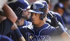 Tampa Bay Rays' Desmond Jennings celebrates with teammates in the dugout after hitting solo home run during the third inning of a baseball game against the Chicago Cubs in Chicago, Friday, Aug. 8, 2014. (AP Photo/Paul Beaty)