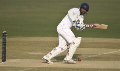 Sri Lanka's Kumar Sangakkara plays a shot on the first day of the second test cricket match against Bangladesh in Chittagong, Bangladesh, Tuesday, Feb. 4, 2014. Sangakkara's 34th century steered Sri Lanka to a commanding 314-5 against Bangladesh at stumps Tuesday.(AP Photo)