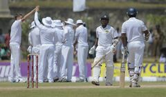 Sri Lankan batsmen Mahela Jayawardene, second right, leaves the filed after being dismissed as South African team members celebrate during the fifth day of the first test cricket match in Galle, Sri Lanka, Sunday, July 20, 2014. (AP Photo/Eranga Jayawardena)