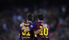 FC Barcelona's Lionel Messi from Argentina, right, reacts after scoring with his teammate Munir against Elche during a Spanish La Liga soccer match at the Camp Nou stadium in Barcelona, Spain, Sunday, Aug. 24, 2014. (AP Photo/Manu Fernandez)