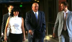 Former Minnesota Gov. Jesse Ventura, center, arrives at court with his wife, Terry, and others, Tuesday, July 22, 2014 in St. Paul, Minn. Closing arguments are set for Tuesday in Ventura's defamation lawsuit against the estate of