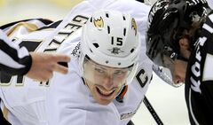 FILE - In this Nov. 16, 2011 file photo, Anaheim Ducks center Ryan Getzlaf, left, and Los Angeles Kings center Anze Kopitar, of Slovenia, wait for the linesman to drop the puck during the first period of an NHL hockey game in Los Angeles. The Anaheim Ducks have re-signed captain Getzlaf to an eight-year contract. The Ducks announced the deal Friday March 8, 2013.. (AP Photo/Mark J. Terrill, File)