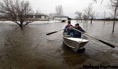 Denis and Judy Verrier go for a little boat ride around their property.