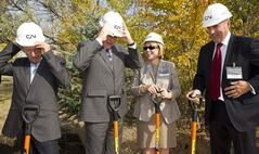 Mayor Sam Katz (from left), Premier Greg Selinger and CN Rail's Kim Madigan and John Orr don their hard hats prior to turning the sod on the new training centre at CN's Transcona yards Friday morning.