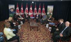 Prime Minister Stephen Harper (centre left) attends a round table meeting on cyberbulling at the Delta Inn in Winnipeg Friday. The discussion included family members of victims of cyberbulling.