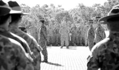 U.S. Marine Corps personnel stand at attention with the 5th Battalion Royal Australian Regiment during an official welcome ceremony at Robertson Barracks, in Darwin, Australia.
