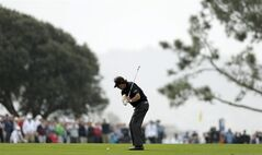 Phil Mickelson hits his second shot from the fairway of the second hole of the south course during the second round of the Farmers Insurance Open golf tournament Friday, Jan. 24, 2014, in San Diego. (AP Photo/Gregory Bull)