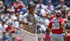 San Diego Padres' Everth Cabrera flings away his bat after striking out to end the sixth inning against the Washington Nationals during a baseball game, Sunday, June 8, 2014, in San Diego. The Padres have struck out 11 times through eight innings while mustering only two hits. (AP Photo/Lenny Ignelzi)