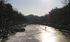People skate on the frozen Keizersgracht canal in Amsterdam, Netherlands, Tuesday Feb. 7, 2012. (AP Photo/Margriet Faber)