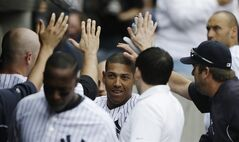 New York Yankees' Yangervis Solarte celebrates with teammates after hitting a home run during the fourth inning of a baseball game against the Minnesota Twins Saturday, May 31, 2014, in New York. (AP Photo/Frank Franklin II)
