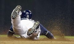 Milwaukee Brewers' Carlos Gomez steals second during the seventh inning of a baseball game against the Colorado Rockies on Thursday, June 26, 2014, in Milwaukee. (AP Photo/Morry Gash)