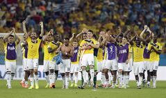 FILE - In this June 28, 2014, file photo, Colombia's James Rodriguez (10) is lifted off his feet by his teammates following Colombia's 2-0 victory over Uruguay during the World Cup round of 16 soccer match between Colombia and Uruguay at the Maracana Stadium in Rio de Janeiro, Brazil. Never before has the star-crossed nation made the quarterfinals. There is even waxing poetic about World Cup unity accelerating the pace of 18-month-old peace talks to end a half-century of conflict that has claimed some 220,000 lives. (AP Photo/Marcio Jose Sanchez, File)