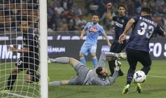 Inter Milan goalkeeper Samir Handanovic, of Slovenia, saves during a Serie A soccer match between Inter Milan and Napoli, at the San Siro stadium in Milan, Italy, Saturday, April 26, 2014. (AP Photo/Luca Bruno)