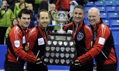 Ontario skip Glenn Howard, right to left, third Wayne Middaugh, second Brent Laing and lead Craig Savill hold the Brier Trophy following the gold medal draw against Alberta at the Tim Hortons Brier in Saskatoon, Sask. Sunday, March, 11, 2012. THE CANADIAN PRESS/Derek Mortensen