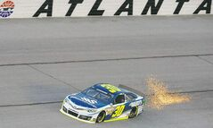 Sparks fly from Sprint Cup Series driver David Stremme�s Toyota during qualifying for Sunday�s NASCAR Sprint Cup Series auto race at Atlanta Motor Speedway, Friday, Aug. 30, 2013 in Hampton, Ga. (AP Photo/David Tulis)