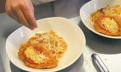 49.8 - rrc food column.  Alex Wong prepares Chicken Parmigiana  in the kitchen of the RRC School of Hospitality and Culinary Arts. Keith F. M�����ller story Wayne Glowacki / Winnipeg Free Press Oct. 16 2013
