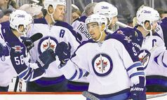 Evander Kane celebrates his second goal against Pittsburgh Sunday. While some Jets have come close, none has scored a hat trick since almost a year before moving to Winnipeg.