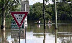 Emergency Service workers kayak their way through flood waters caused by torrential rains in Lismore,  northern New South Wales, Australia, following torrential rains.