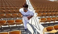 Los Angeles Dodgers pitcher Hyun-Jin Ryu, of South Korea, runs stairs during spring training baseball practice in Glendale, Ariz., Friday, Feb. 14, 2014. (AP Photo/Paul Sancya)