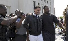 Singer Chris Brown leaves the D.C. Superior Court, in Washington, Wednesday, June 25, 2014. Attorneys for Brown and prosecutors have been unable to reach a plea agreement in his assault case in Washington. Prosecutor Kevin Chambers said Wednesday they offered a deal for Brown to plead guilty to simple assault and time served. But the award-winning singer's attorney, Mark Geragos, says defense lawyers and prosecutors couldn't agree on a statement of facts about what happened in October outside the W hotel. (AP Photo/Susan Walsh)