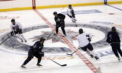 Winnipeg Jets players skate in the MTS Centre for the first time since the NHL lockout ended.