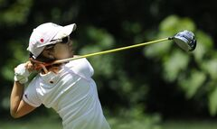Mamiko Higa, of Japan, drives off the second hole during the third round of the International Crown golf tournament on Saturday, July 26, 2014, in Owings Mills, Md.(AP Photo/Gail Burton)